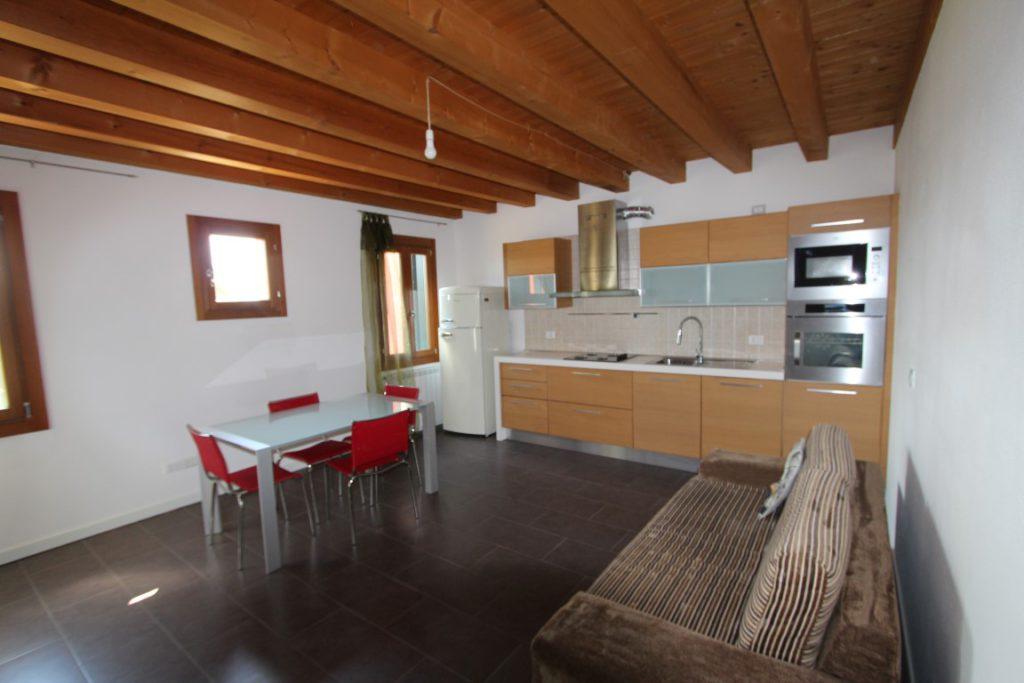 soggiorno angolo cottura appartamento concordia sagittaria